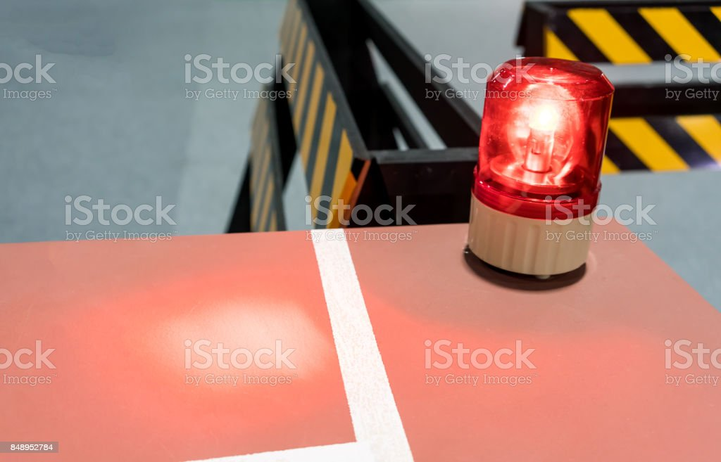Red siren on metal cabinet. Warning light for safety on work area. stock photo