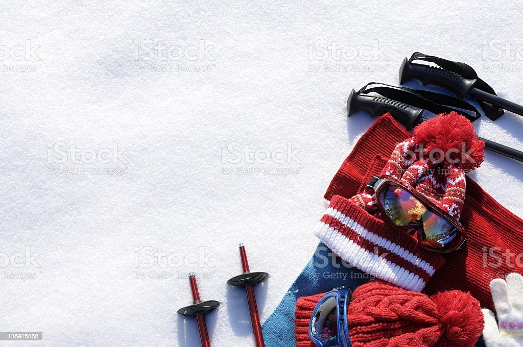 Red ski gear displayed on snow stock photo