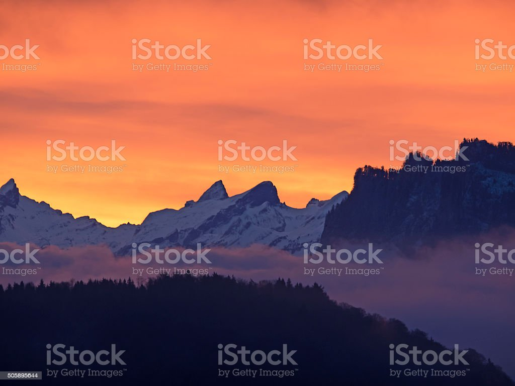 Red sky over the Mountains at sunrise stock photo