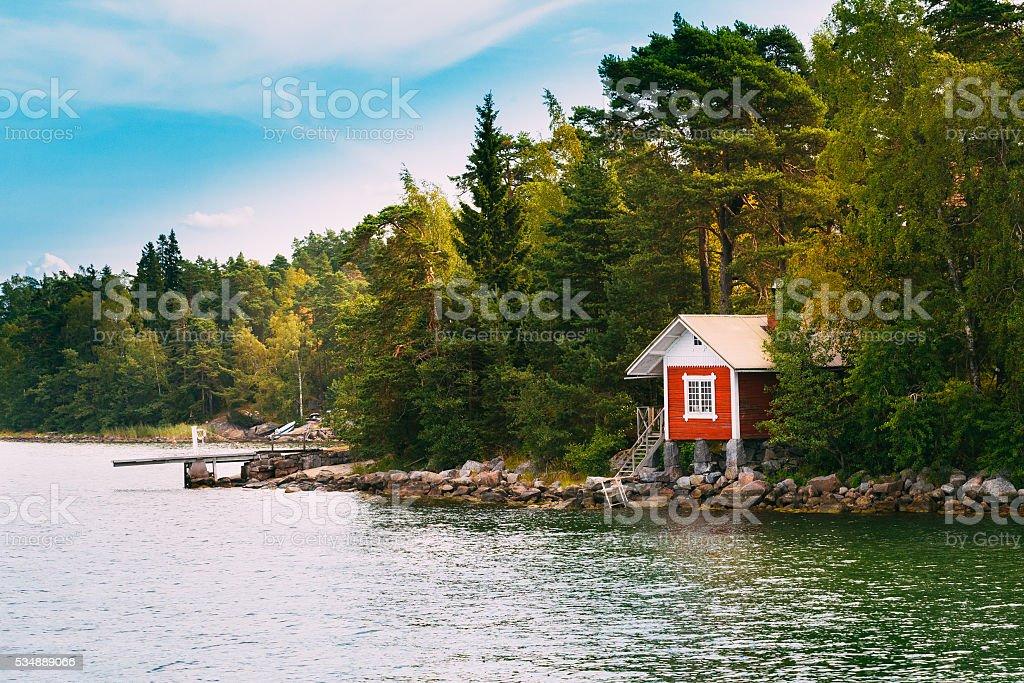 Red Small Finnish Wooden Sauna Log Cabin  Island Autumn Season stock photo