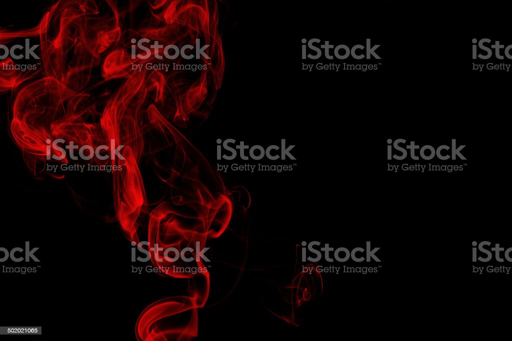 Red smoke on black background royalty-free stock photo
