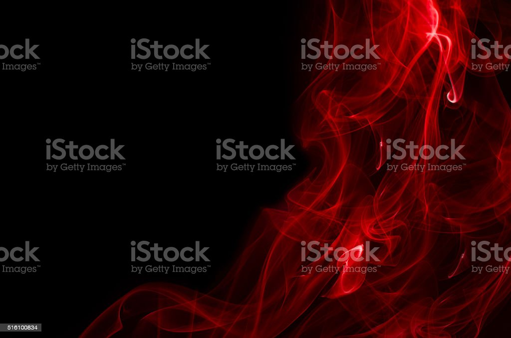 Red smoke on black background stock photo
