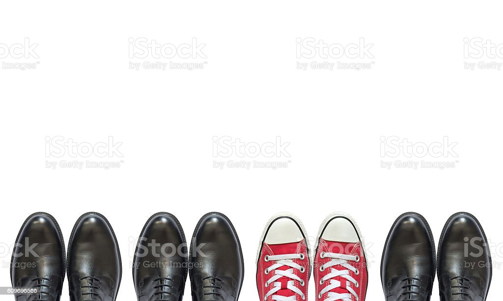 red sneakers and man business shoes stock photo
