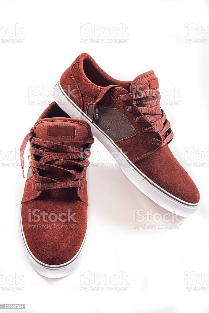 Red sneakers isolated stock photo