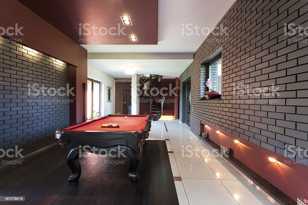 Red snooker table in a luxurious room stock photo