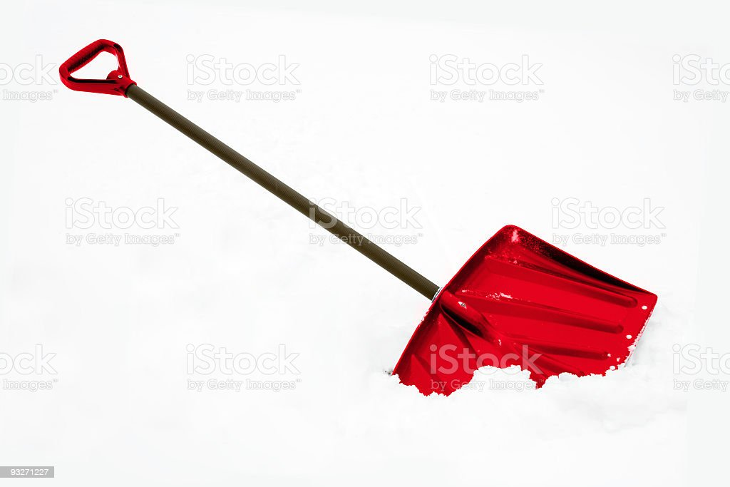 A red snow shovel stuck in the snow royalty-free stock photo