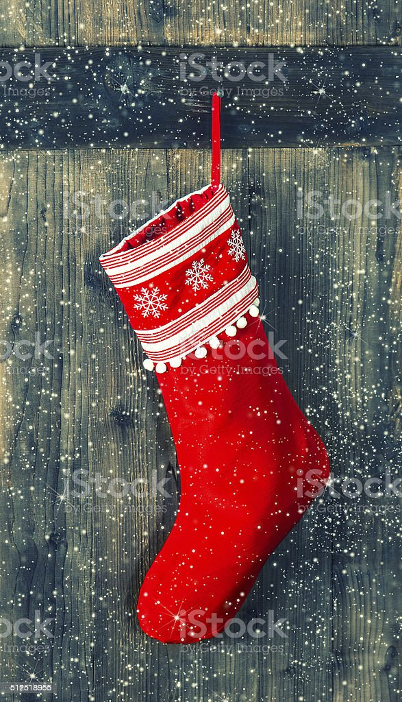 red sock for Santa gifts. christmas stocking stock photo