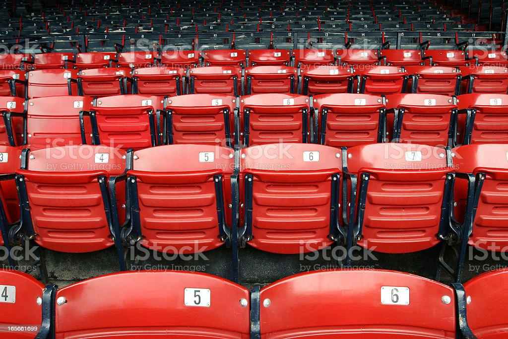 Red socks seats when no one is there stock photo