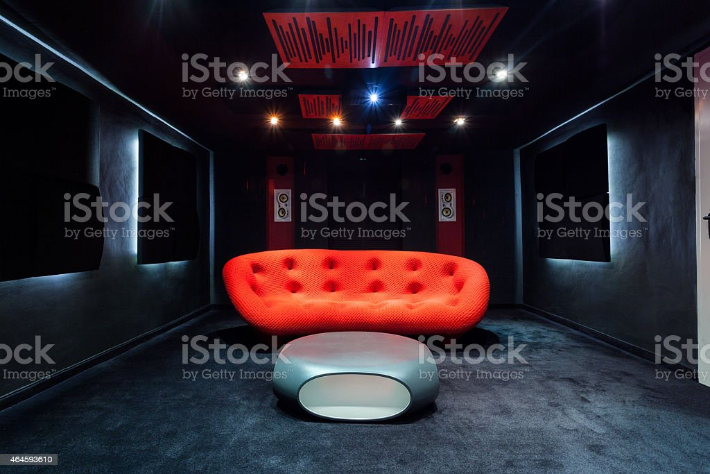 Red sofa in the basement stock photo