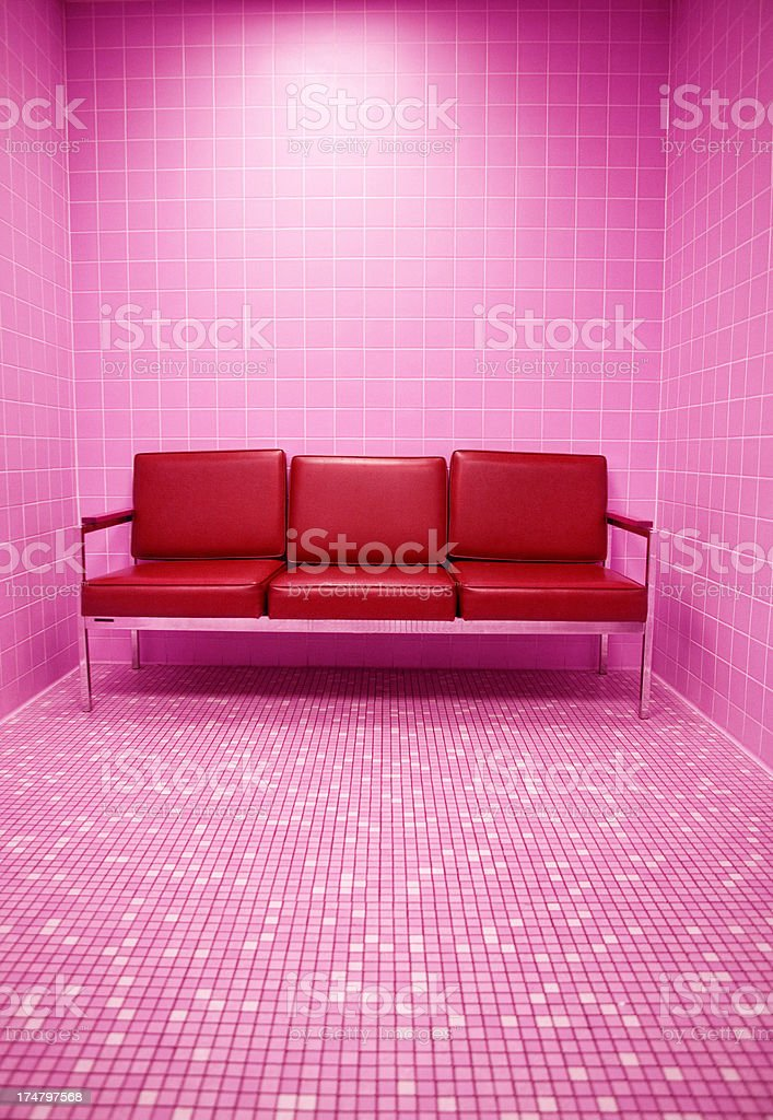 Red Sofa in Tiled Room royalty-free stock photo