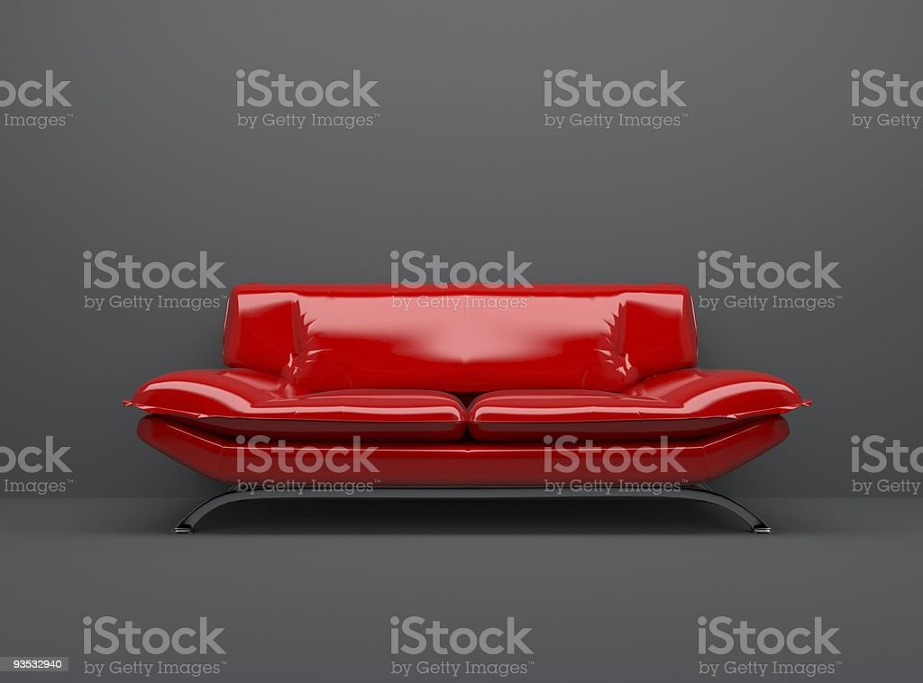 red sofa isolated on deep gray background royalty-free stock photo