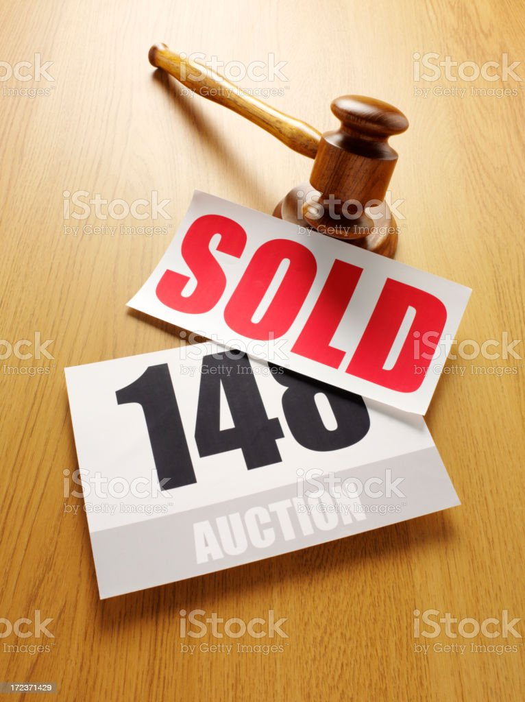 Red Sold Sign with a Auction Paddle and Gavel stock photo