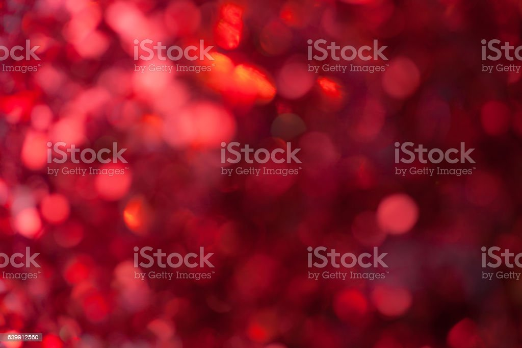 Red sparkling background from small sequins, closeup. Brilliant backdrop stock photo