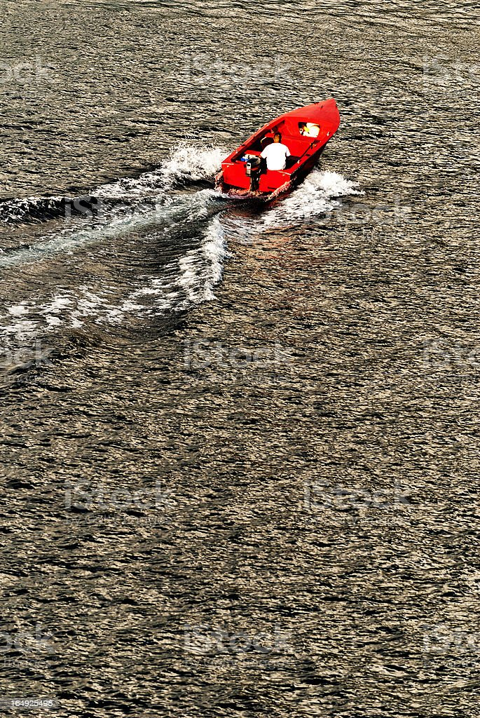Red speedboat in sunset royalty-free stock photo