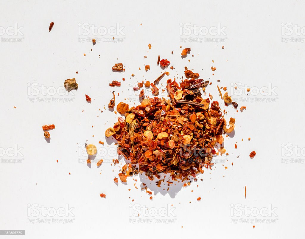 Red spice from overhead shoot with white background stock photo