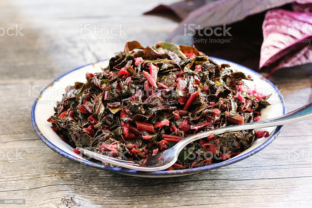 Red Spinach stir fry, selective focus stock photo