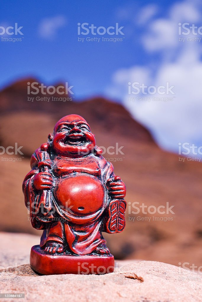 Red Spiritual Journey Buddha and Sandstone Hills royalty-free stock photo