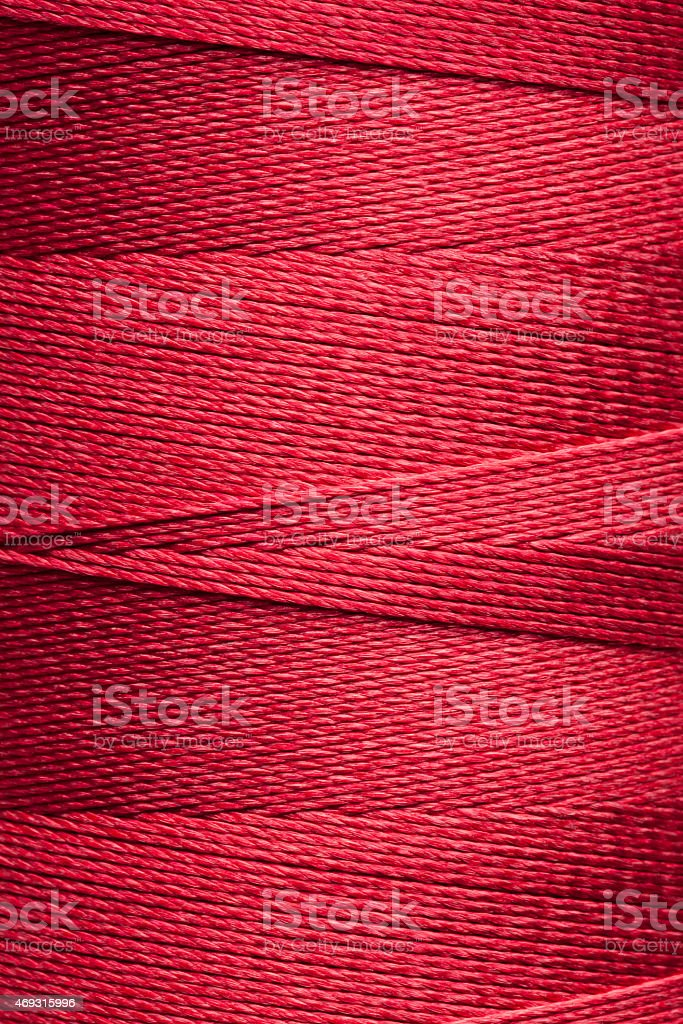 Red spool of thread stock photo