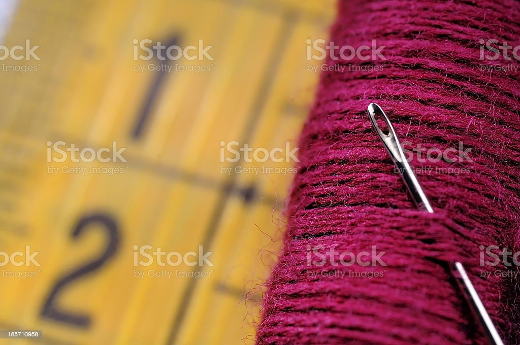 red spool on measuring tape royalty-free stock photo