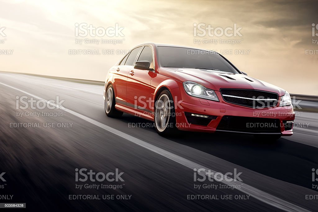 Red Sport car Mercedes-Benz C63 AMG drive on asphalt road stock photo