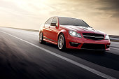 Red Sport car Mercedes-Benz C63 AMG drive on asphalt road