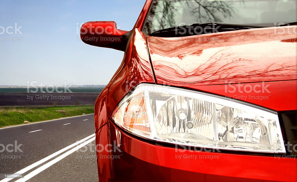 Red Sport car on a highway stock photo