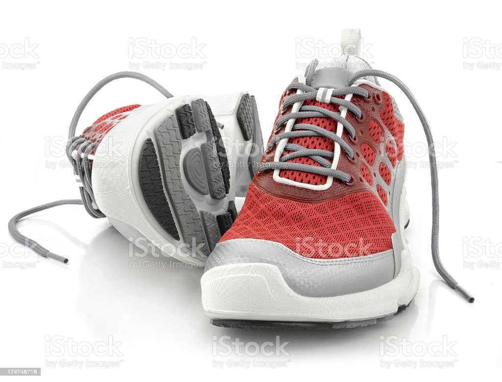 Red sport sneakers isolated on white background stock photo