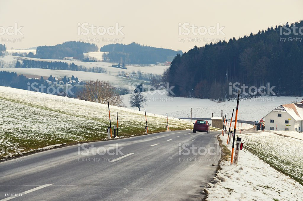 Red sports car driving along a mountain pass stock photo