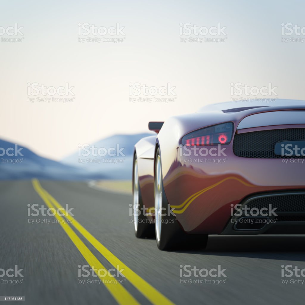 Red Sports car in a road through the mountains stock photo