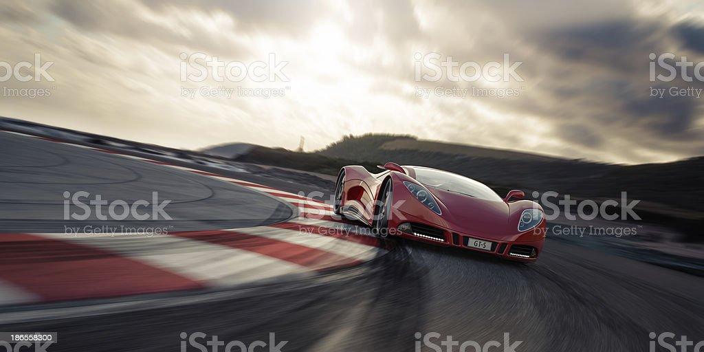 Red sports car on racetrack stock photo