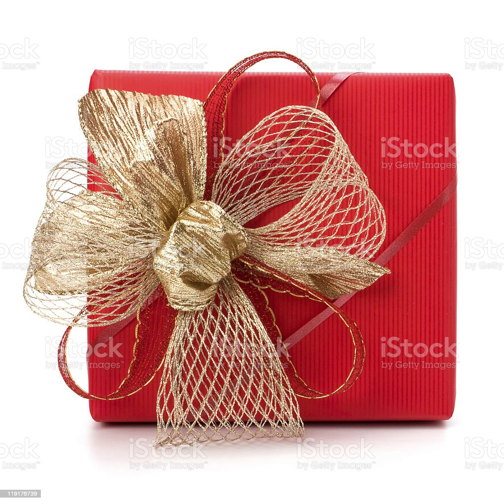 A red square gift box wrapped with ribbon and a gold bow royalty-free stock photo