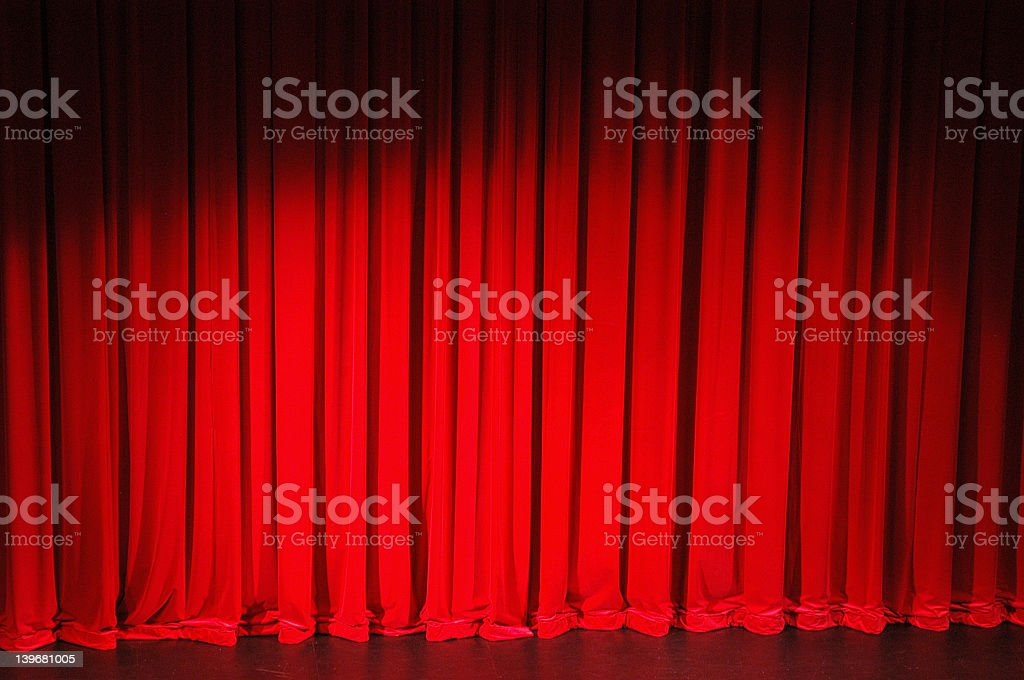 Red stage curtain lowered to stage royalty-free stock photo