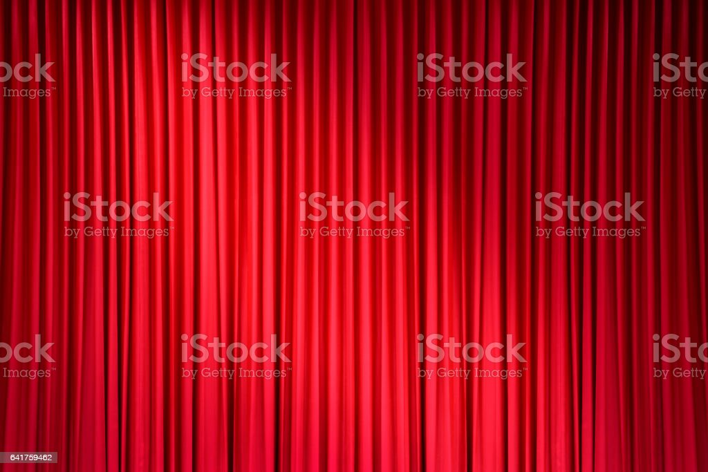 red stage curtain with light spots stock photo