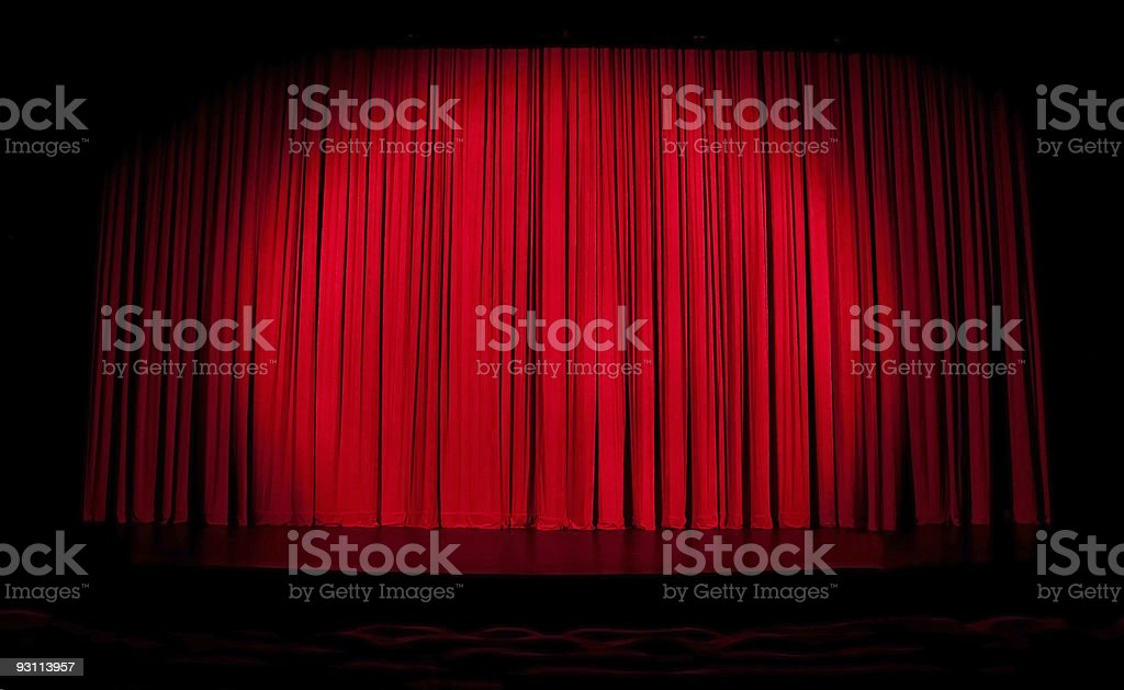 Red stage curtain with spotlight stock photo