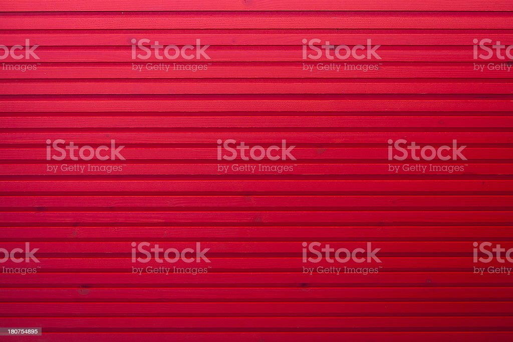 red stained plank of a wooden wall royalty-free stock photo