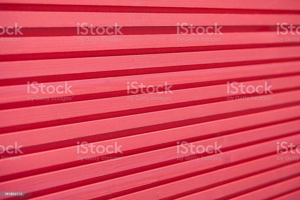 red stained plank of a wooden wall stock photo