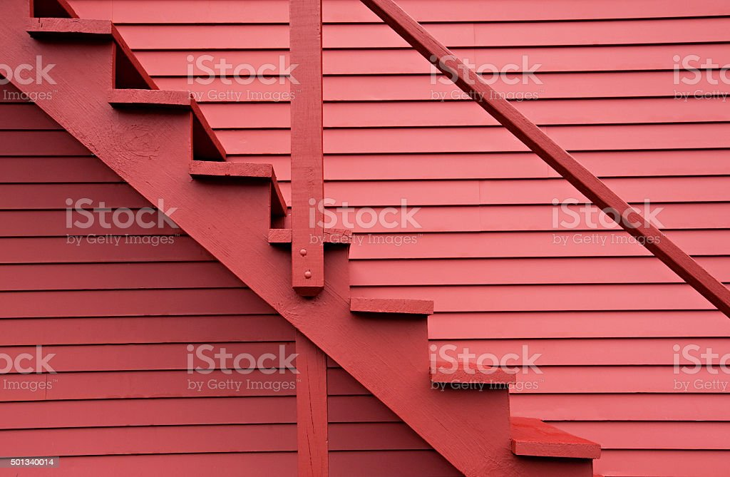 Red stairs of the red barn stock photo