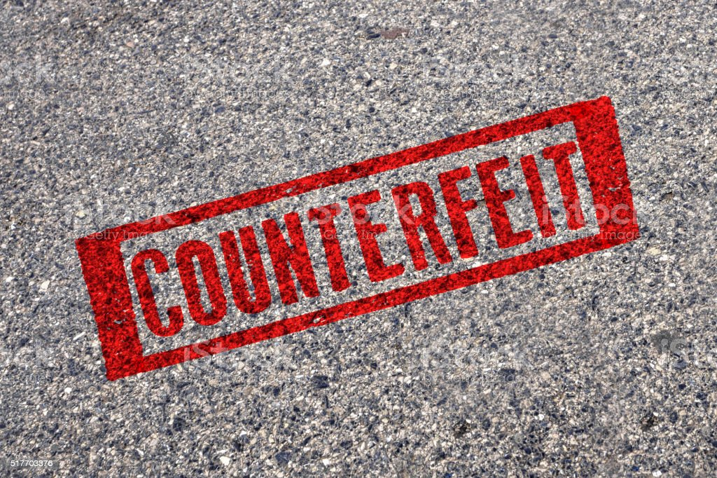 Red Stamp - Counterfeit stock photo