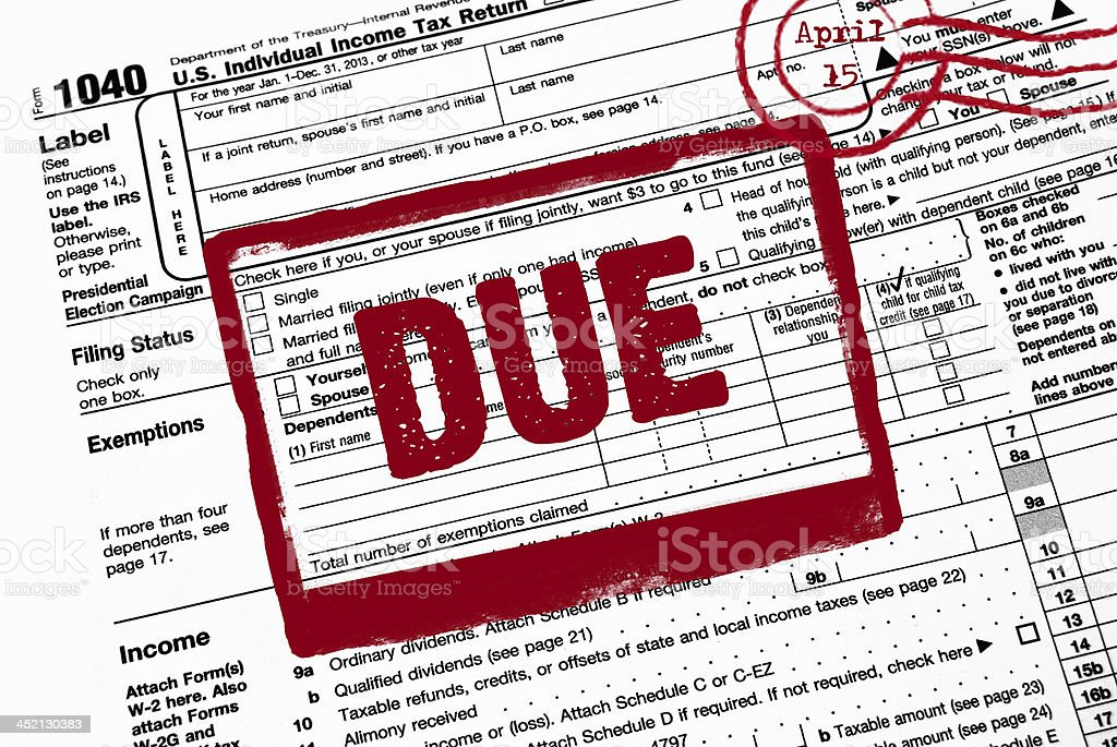 red stamp on tax form stock photo