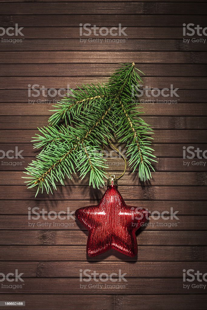 red star and Christmas tree branch royalty-free stock photo