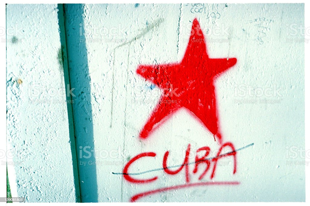 A red star with a red crossed-out Cuba written under it royalty-free stock photo