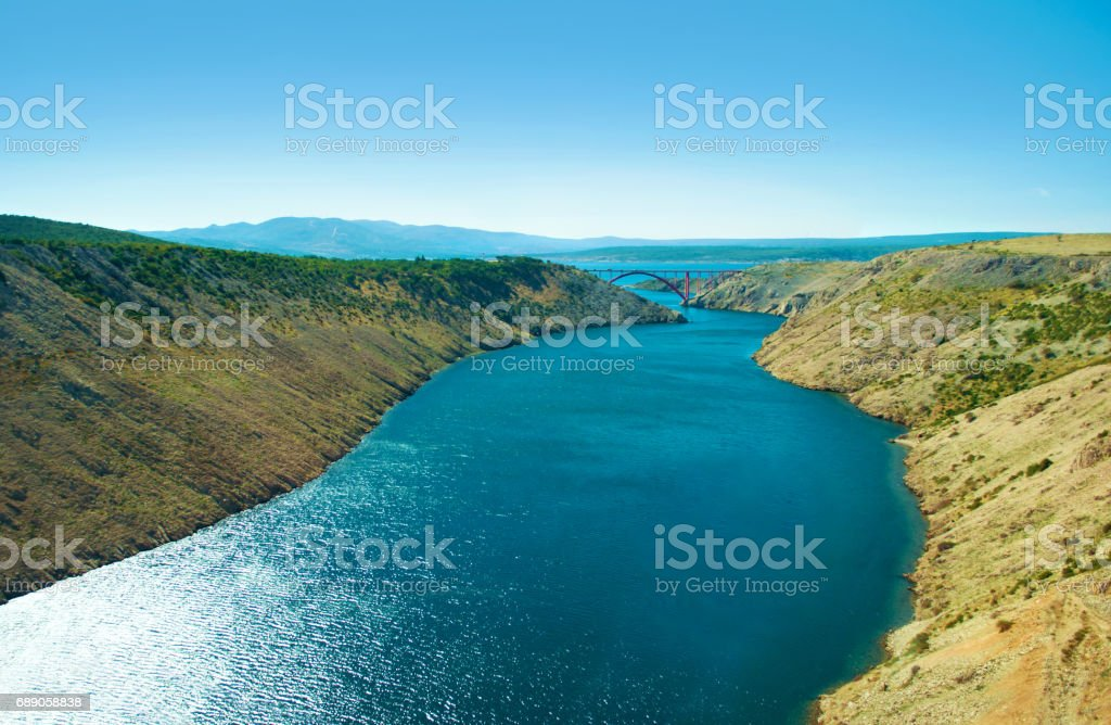 Red steel Maslenica Bridge in the distance stock photo