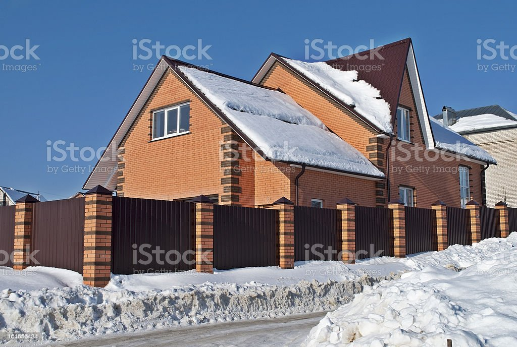 Red stone country house in winter royalty-free stock photo