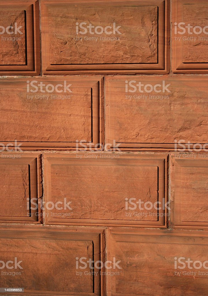 red stone wall background stock photo