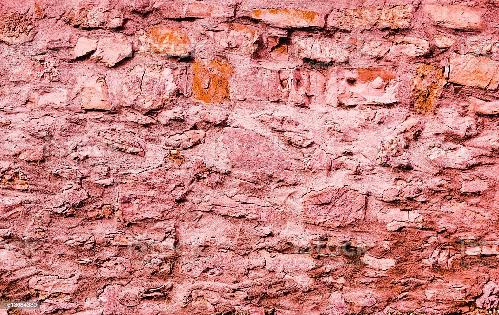 Red stone wall stock photo