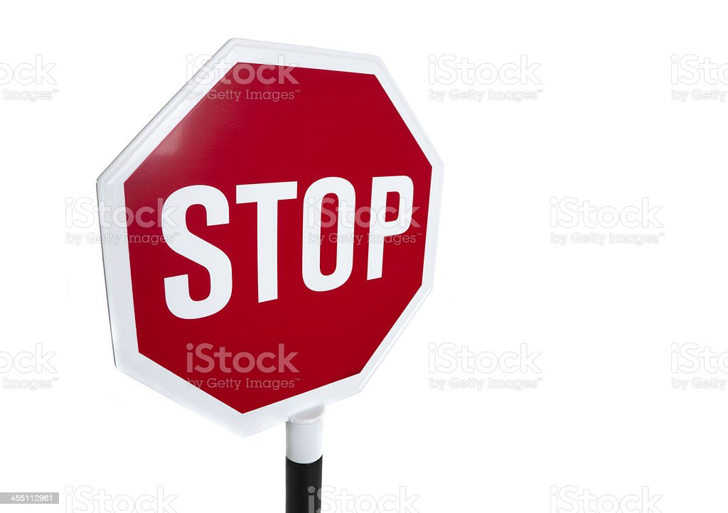Red 'stop' sign on a white background stock photo