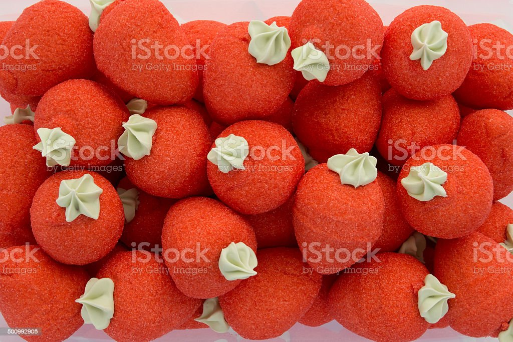 Red strawberries bonbons on white background stock photo