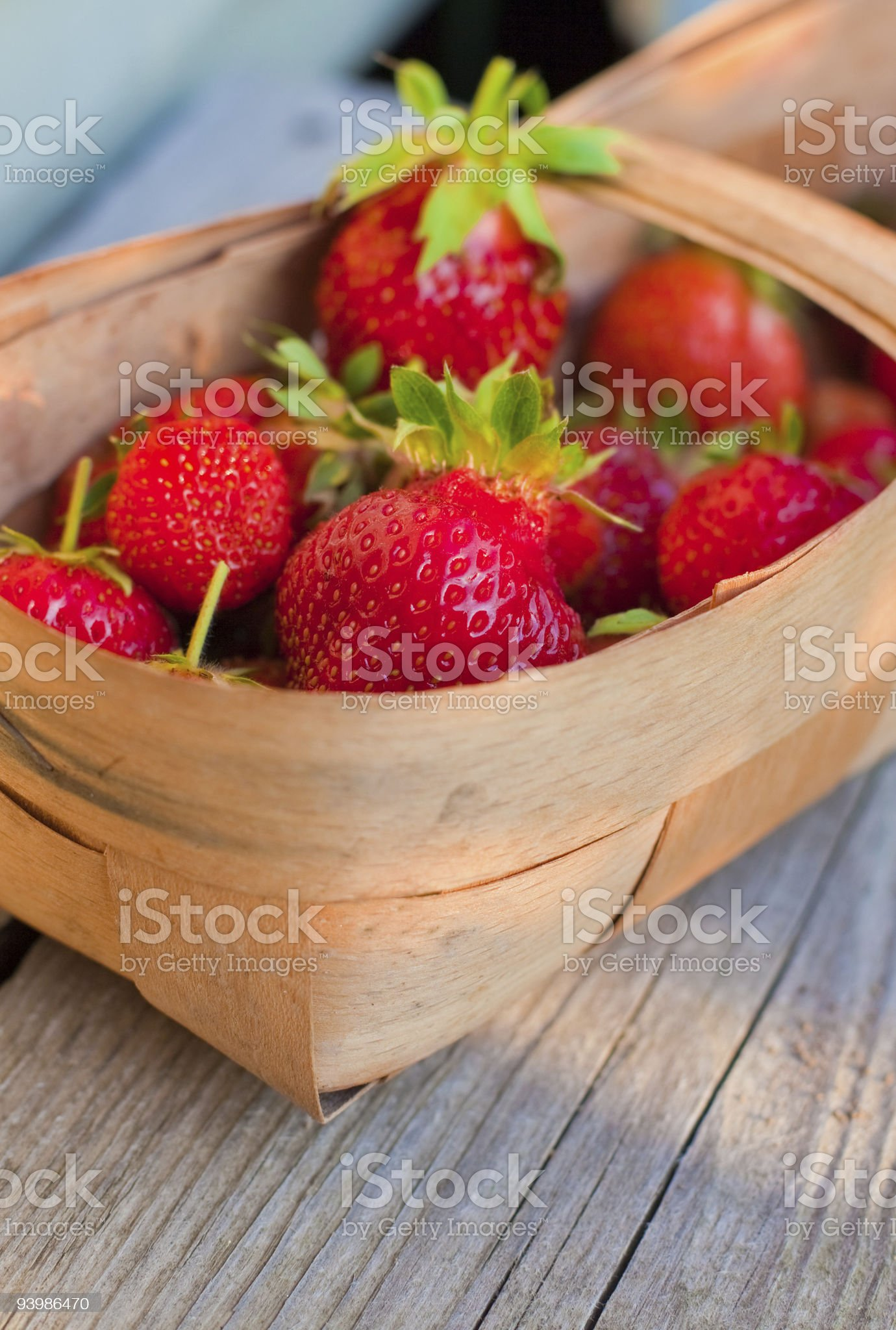 red strawberries in twiggen basket royalty-free stock photo