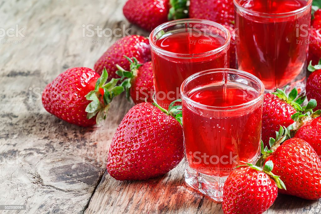Red strawberry drink and fresh berries stock photo