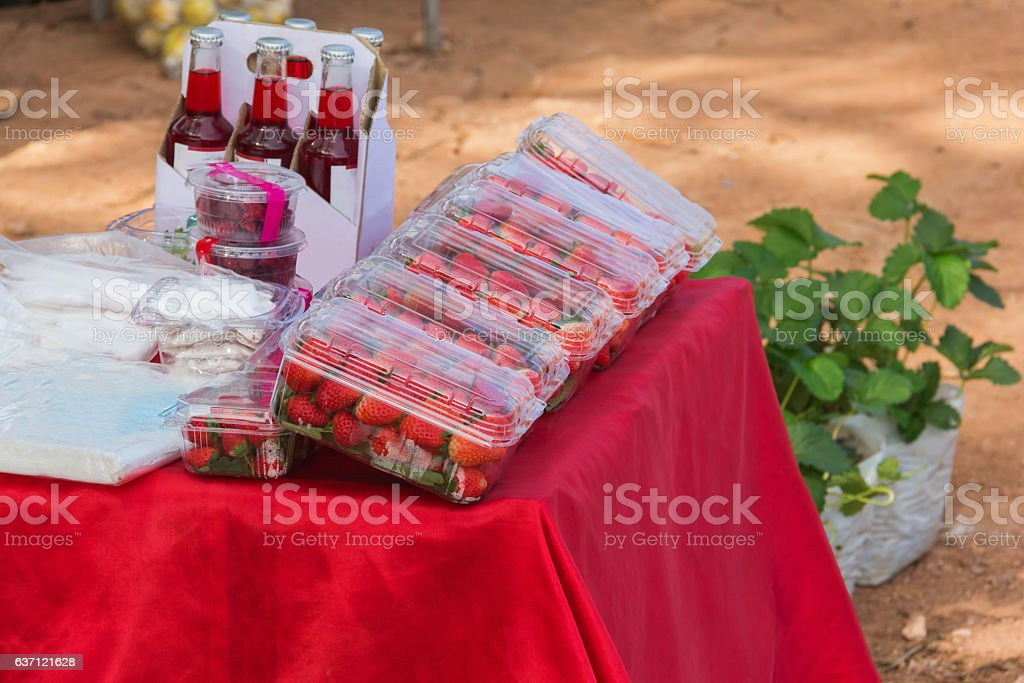 red strawberry in bag for sale stock photo